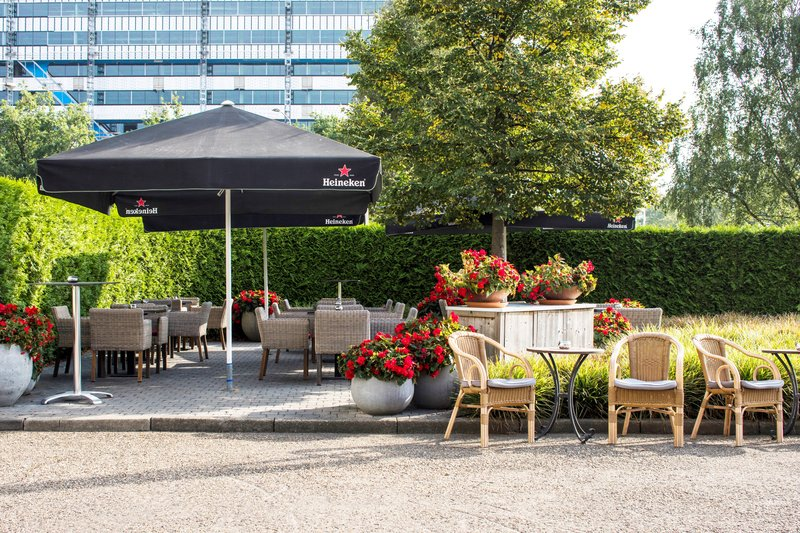 Holiday Inn Eindhoven-Enjoy the sun on our guest patio<br/>Image from Leonardo