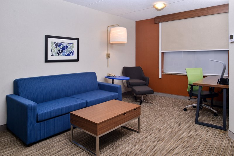 Holiday Inn Express & Suites Buffalo Downtown-King suite livingroom area with sofabed and desk<br/>Image from Leonardo