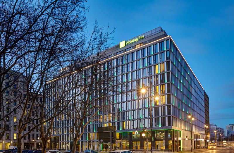 Holiday Inn Berlin Centre Alexanderplatz-Hotel Exterior at Night. Enjoy a walk around the neighbourhood.<br/>Image from Leonardo