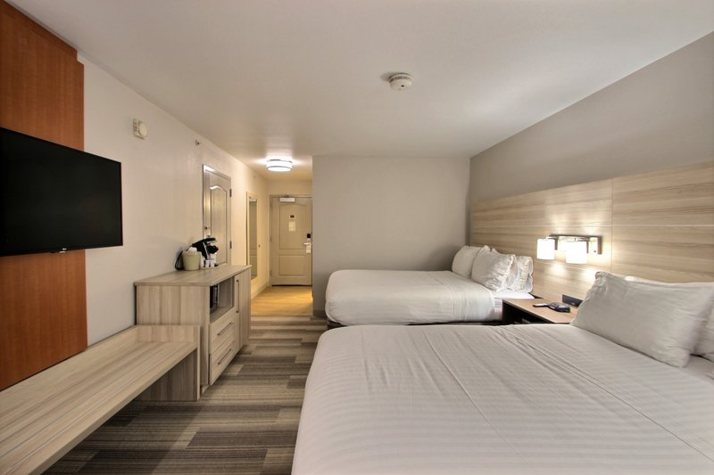 Holiday Inn Express & Suites Milwaukee Airport-Double Queen Guest Room<br/>Image from Leonardo