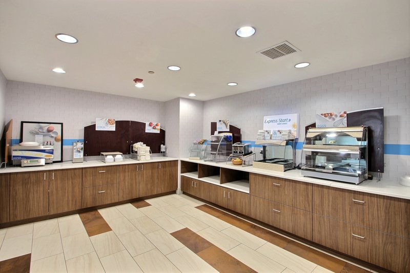 Holiday Inn Express & Suites Milwaukee Airport-Breakfast Area at hotel near by Mitchell International Airport<br/>Image from Leonardo