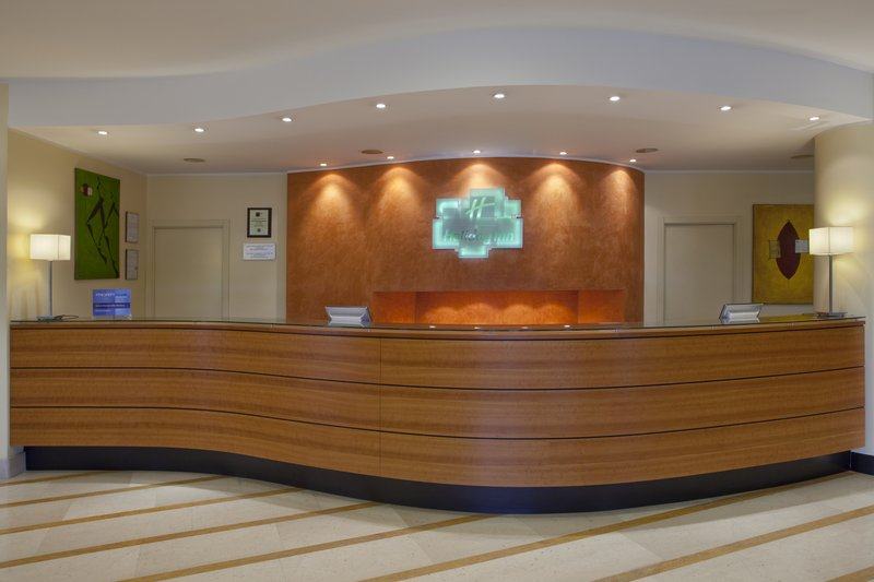 Holiday Inn Cagliari-New HI logo: front desk showing the signs of changing<br/>Image from Leonardo