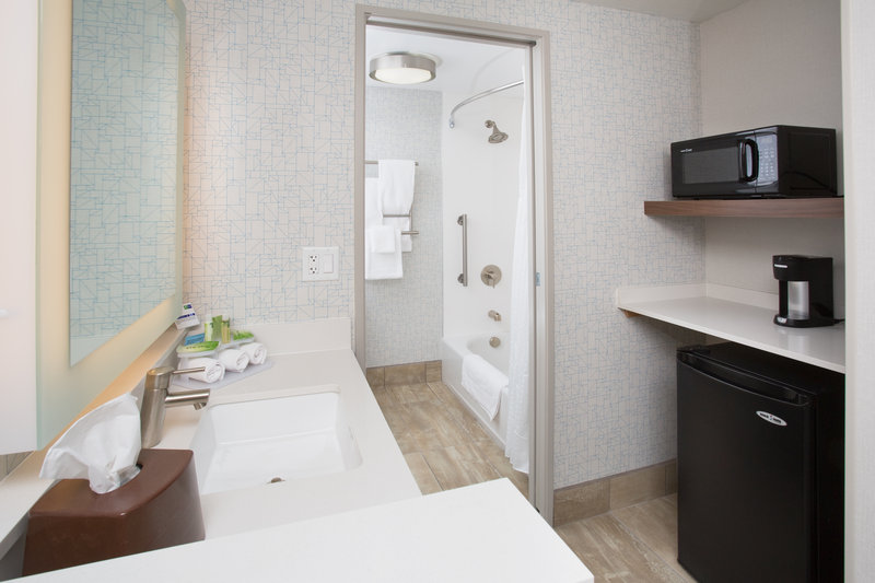 Holiday Inn Express Salt Lake City Downtown-Guest bathroom area and entry including microwave and refrigerator<br/>Image from Leonardo