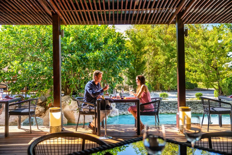 Sanctuary Cap Cana - Pacific Wok Restaurant Outdoor Couple <br/>Image from Leonardo