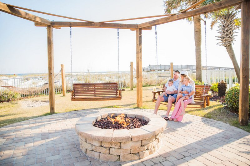 Holiday Inn Resort Pensacola Beach Gulf Front-One of our fire pits with a great view of the beach<br/>Image from Leonardo
