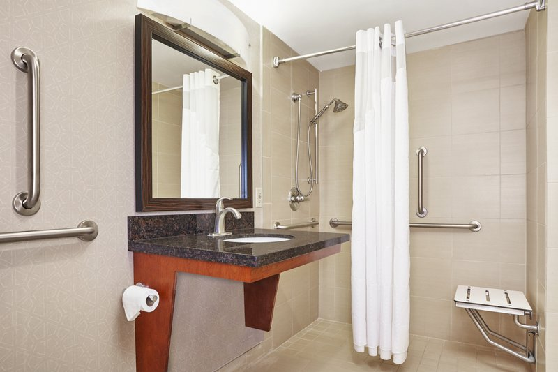 Holiday Inn Express Hampton - Coliseum Central-ADA/Handicapped accessible Guest Bathroom with roll-in shower<br/>Image from Leonardo