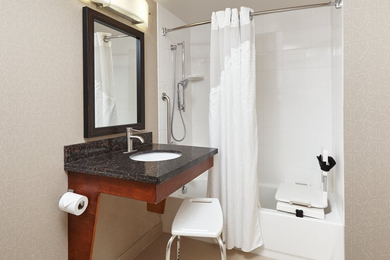 Holiday Inn Express Hampton - Coliseum Central-ADA/Handicapped accessible Guest Bathroom with mobility tub<br/>Image from Leonardo