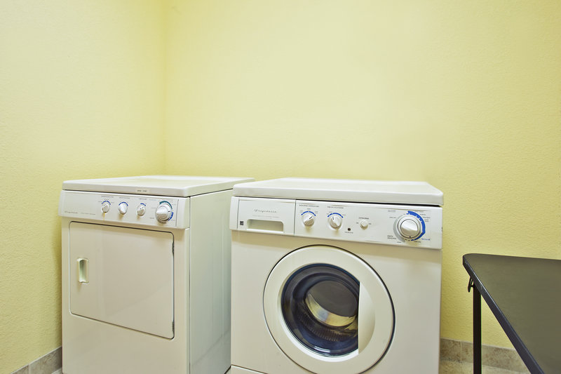 Holiday Inn Express & Suites East Lansing-Guest laundry facility is available 24 hours per day.<br/>Image from Leonardo