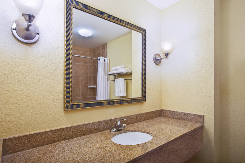 Holiday Inn Express & Suites East Lansing-Our well lit guest bathrooms with granite counter tops.<br/>Image from Leonardo