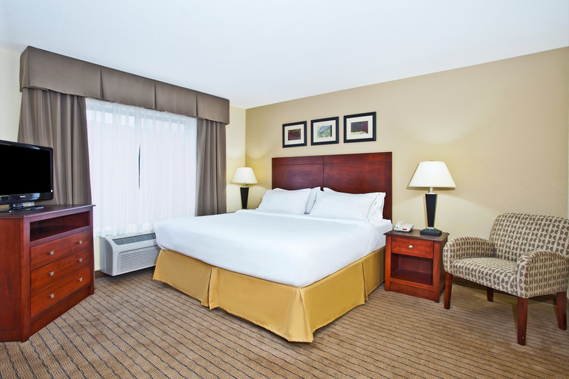 Holiday Inn Express & Suites East Lansing-Enjoy a comfortable king size bed.<br/>Image from Leonardo