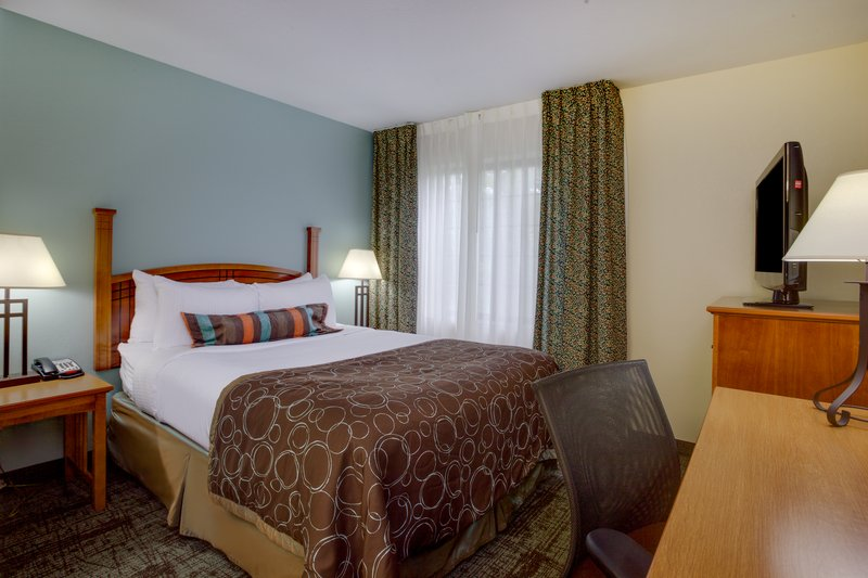 Staybridge Suites Corning-ADA/Handicapped accessible King Suite Bedroom<br/>Image from Leonardo