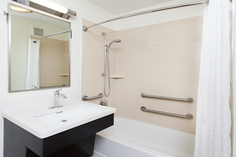 Candlewood Suites Dallas - By The Galleria-Accessible shower<br/>Image from Leonardo