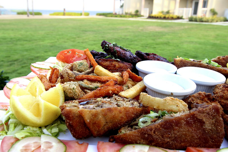 Holiday Inn Resort Grand Cayman-Jerk Chicken Egg Rolls, Fries, wings, meal with a view, groups<br/>Image from Leonardo