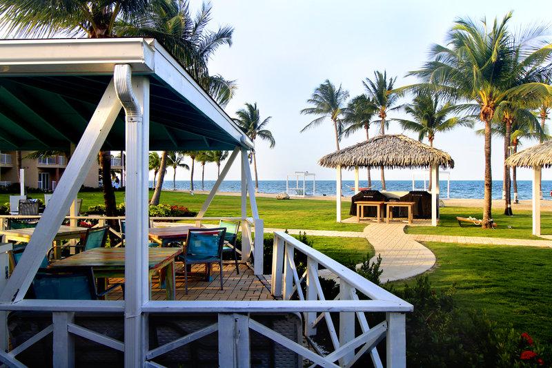 Holiday Inn Resort Grand Cayman-Courtyard, BBQ, family dinner, relax, ocean breeze<br/>Image from Leonardo