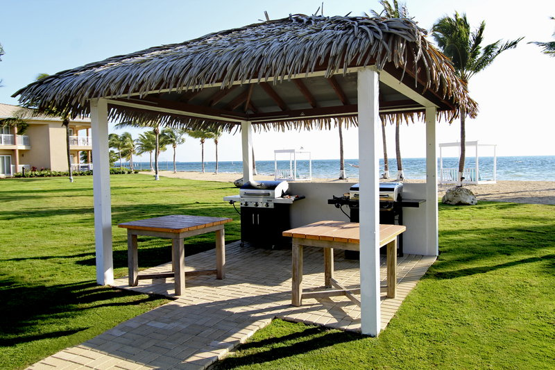 Holiday Inn Resort Grand Cayman-Courtyard, Family BBQ, Outdoor dining, relax under the stars<br/>Image from Leonardo