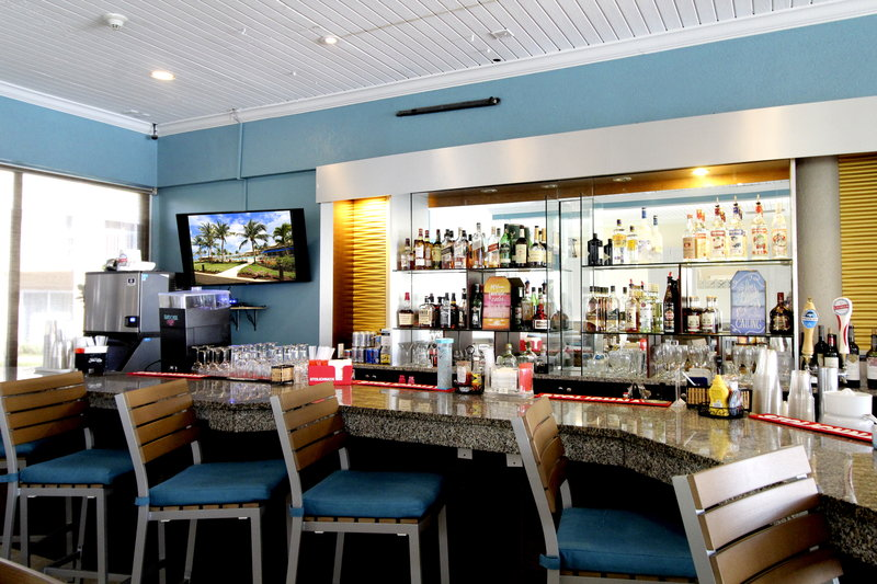 Holiday Inn Resort Grand Cayman-Bar and Lounge, friendly staff, cayman kind, tropical cocktails<br/>Image from Leonardo