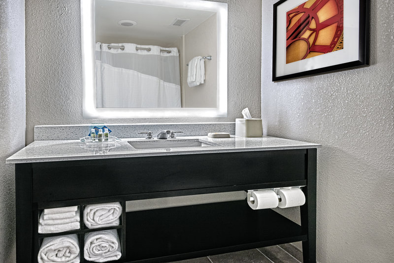 Holiday Inn Hotel & Suites College Station - Aggieland-Our guest bathrooms have plenty of counter space to get ready.<br/>Image from Leonardo