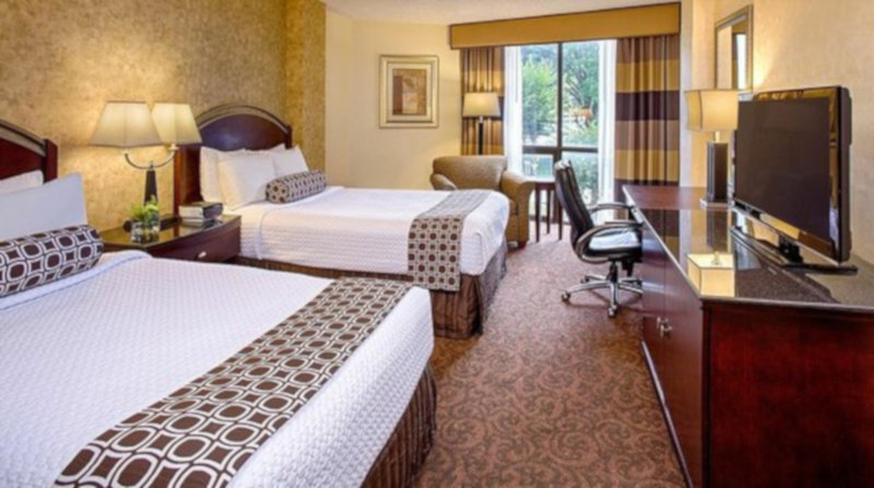 Crowne Plaza Austin-Two double bedded room to accommodate four people.<br/>Image from Leonardo