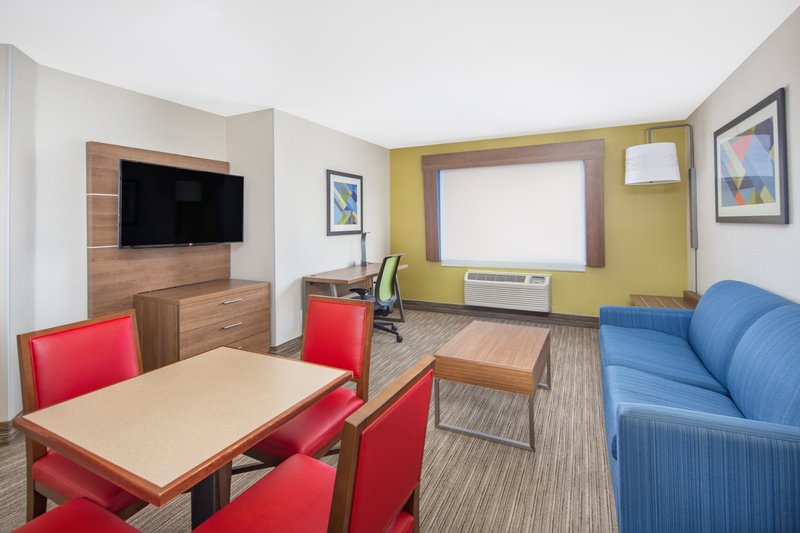 Holiday Inn Express & Suites Bishop-Living Room Area with Sofa Sleeper<br/>Image from Leonardo
