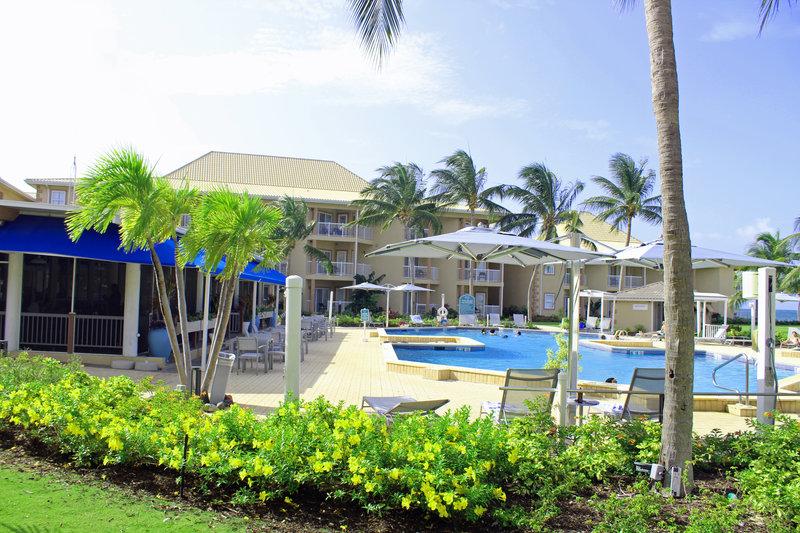 Holiday Inn Resort Grand Cayman-outdoor pool, open air restaurant, outdoor dining, breeze<br/>Image from Leonardo