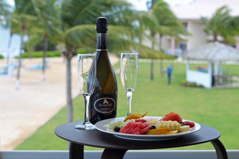 Holiday Inn Resort Grand Cayman-Welcome Gift Amenity, champagne, romance, fruit plate<br/>Image from Leonardo