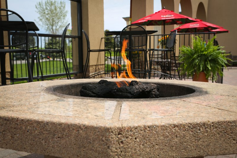 Holiday Inn Fairmont-Guest Patio with firepits is a great place to rest and relax.<br/>Image from Leonardo