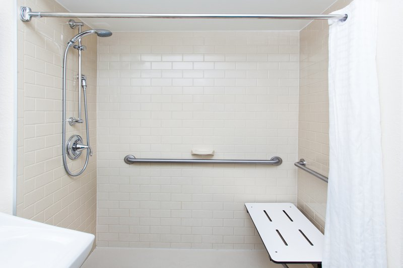 Candlewood Suites Albuquerque-ADA Restroom with Roll in Shower<br/>Image from Leonardo