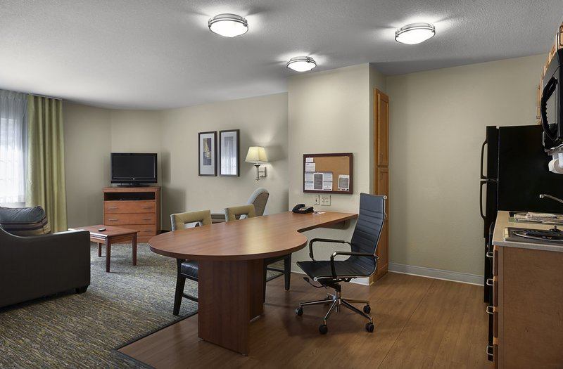 Candlewood Suites Savannah Airport-King studio suite living area, desk and television<br/>Image from Leonardo