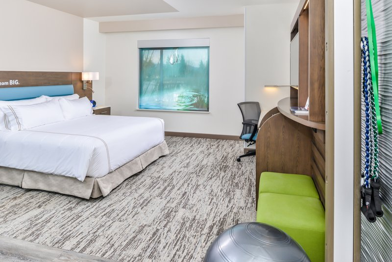 Holiday Inn Express & Suites Ann Arbor-King standard room with in-room trainer and eucalyptus bedding <br/>Image from Leonardo