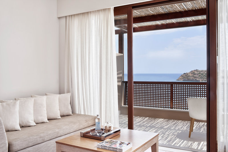 Blue Palace; a Luxury Collection Hotel-Superior Bungalow Sea View Guest Room - Living Area<br/>Image from Leonardo