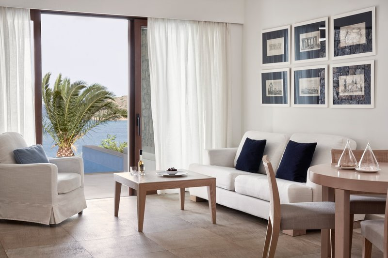 Blue Palace; a Luxury Collection Hotel-Deluxe Suite Sea View Private Pool - Living Area<br/>Image from Leonardo