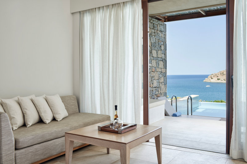Blue Palace; a Luxury Collection Hotel-Superior Bungalow Pool Guest Room - Living Area<br/>Image from Leonardo