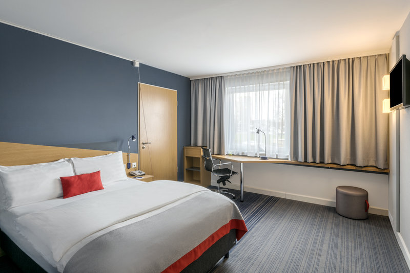 Holiday Inn Express Dortmund-An accessible room with a queen bed and a work station.<br/>Image from Leonardo
