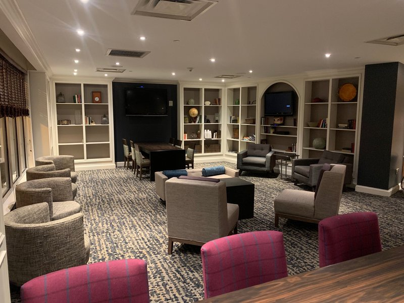 Crowne Plaza Syracuse-Come relax in our Library Lounge.<br/>Image from Leonardo