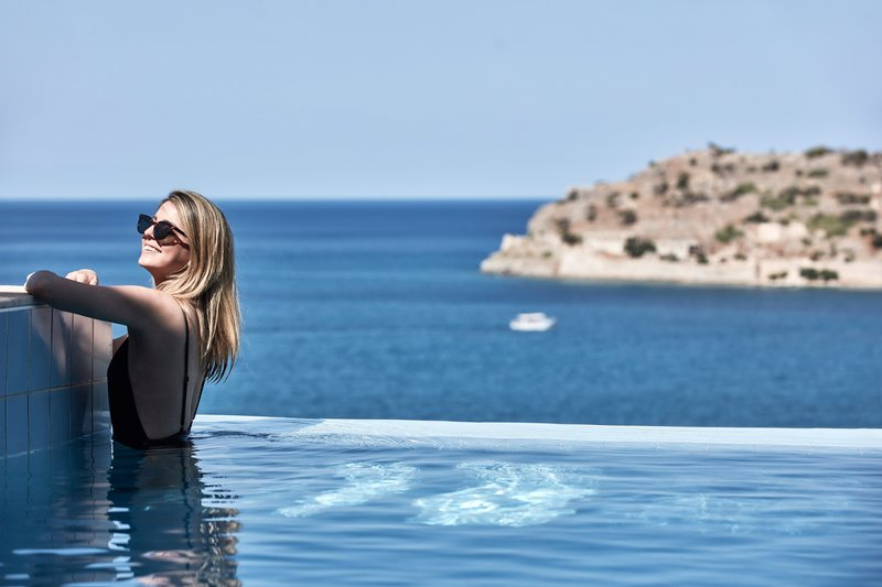 Blue Palace; a Luxury Collection Hotel-Lounging In A Private Infinity Pool<br/>Image from Leonardo