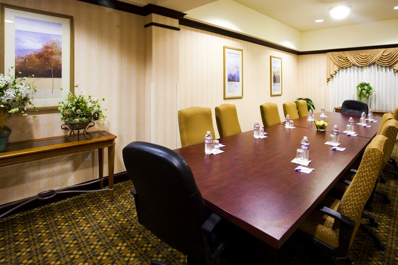 Holiday Inn Express Syracuse Airport-Boardroom ideal for small meeting or deposition.<br/>Image from Leonardo