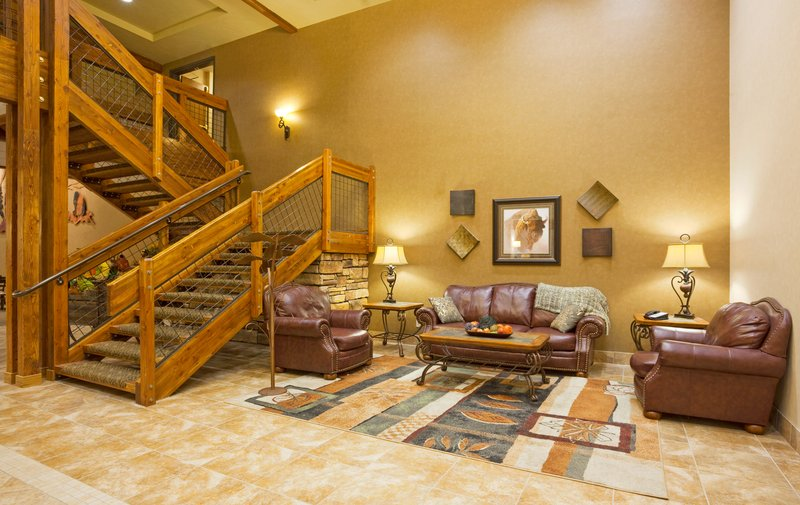 Holiday Inn Express & Suites Custer-Two Story Lobby Area with an eye-catching staircase<br/>Image from Leonardo
