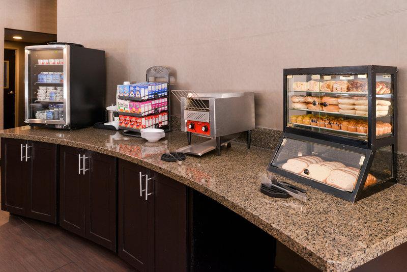 Holiday Inn Amarillo West Medical Center-Bakery goods and fresh fruits for breakfast!<br/>Image from Leonardo