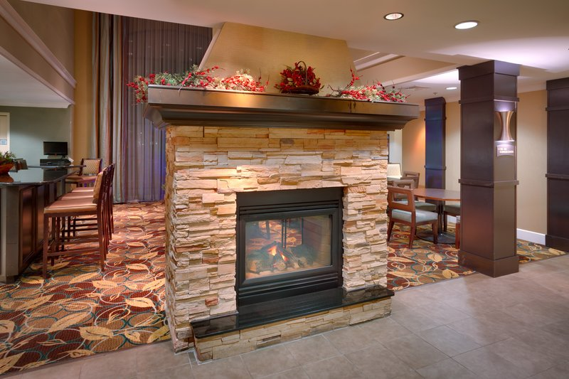 Staybridge Suites Peoria-Downtown-Our fireplace welcomes you all year around<br/>Image from Leonardo
