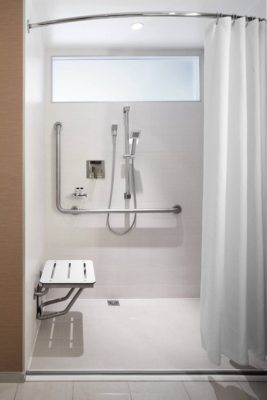 Delta Hotels by Marriott Toronto-Accessible Guest Room Bathroom - ADA Roll-In Shower<br/>Image from Leonardo