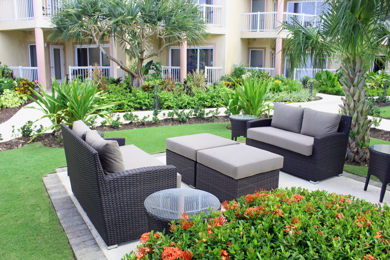 Holiday Inn Resort Grand Cayman-Outdoor lush garden seating<br/>Image from Leonardo