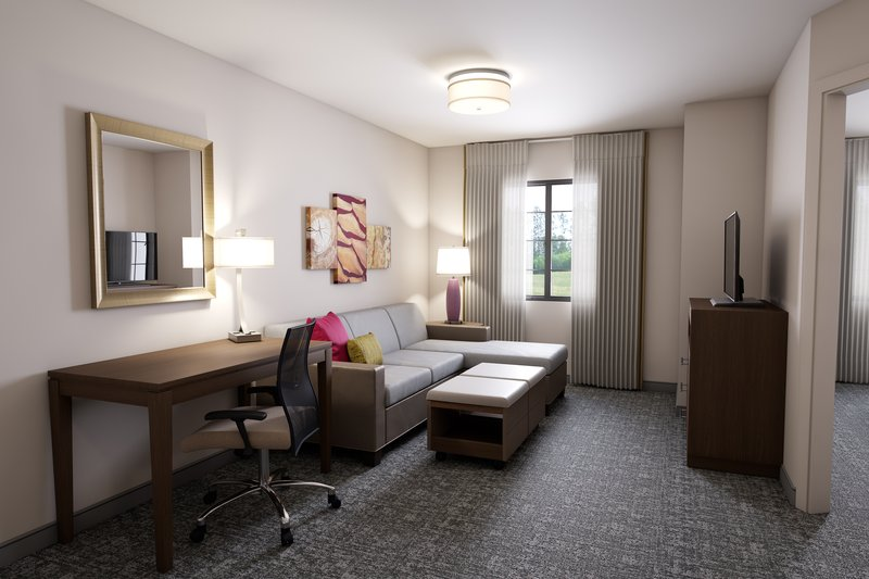 Staybridge Suites Vero Beach-Spacious Living Room with TV and Work Desk<br/>Image from Leonardo