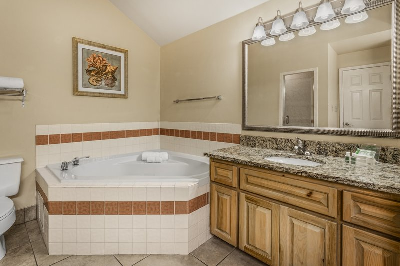 Holiday Inn & Suites Clearwater Beach S Harbour-King Loft Villa bathroom has a Jacuzzi tub and walk in shower.<br/>Image from Leonardo