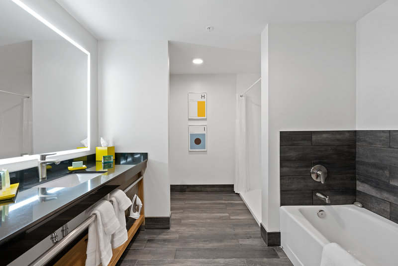 Hotel Indigo Seattle Everett Waterfront-Spacious suite bathroom with standing shower and bathtub<br/>Image from Leonardo
