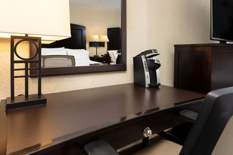 Holiday Inn Hotel & Suites Charleston West-Desks allow space to work while enjoying coffee from the Keurig!<br/>Image from Leonardo