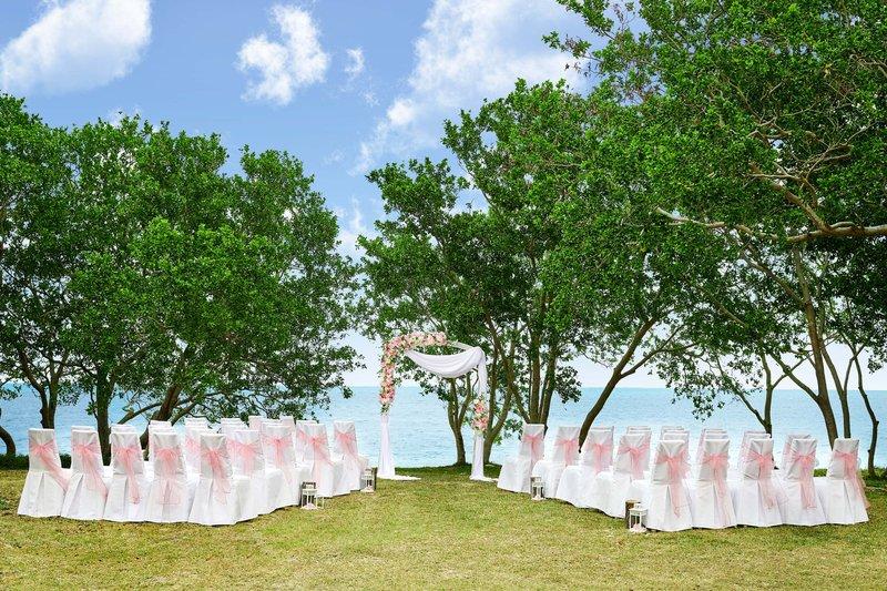 Sheraton New Caledonia Deva Spa And Golf Resort-Wedding Ceremony In The Gardens<br/>Image from Leonardo