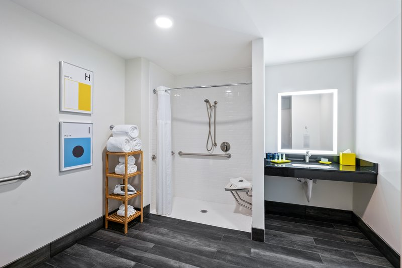 Hotel Indigo Seattle Everett Waterfront-Accessible bathroom with a roll-in shower<br/>Image from Leonardo