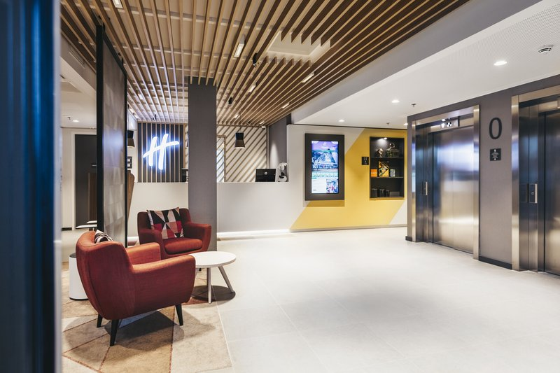 Holiday Inn Eindhoven Airport-Hotel lobby, view towards guest lifts<br/>Image from Leonardo