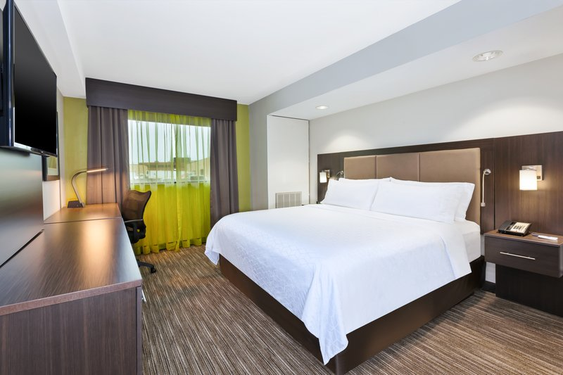 Holiday Inn Express Winnipeg Airport - Polo Park-Our Suite King rooms! Time to relax.<br/>Image from Leonardo
