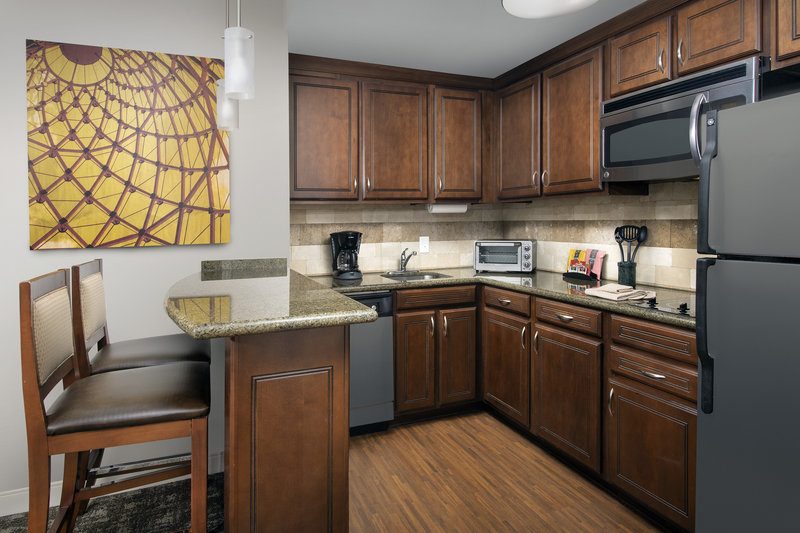 Staybridge Suites Columbia-Kitchen comes complete with dishes, glasses, and silverware<br/>Image from Leonardo
